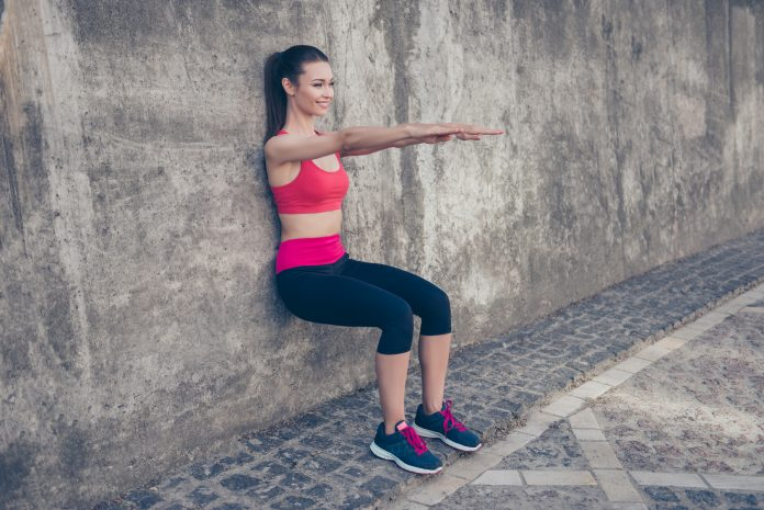 female runner doing Isometric Exercises