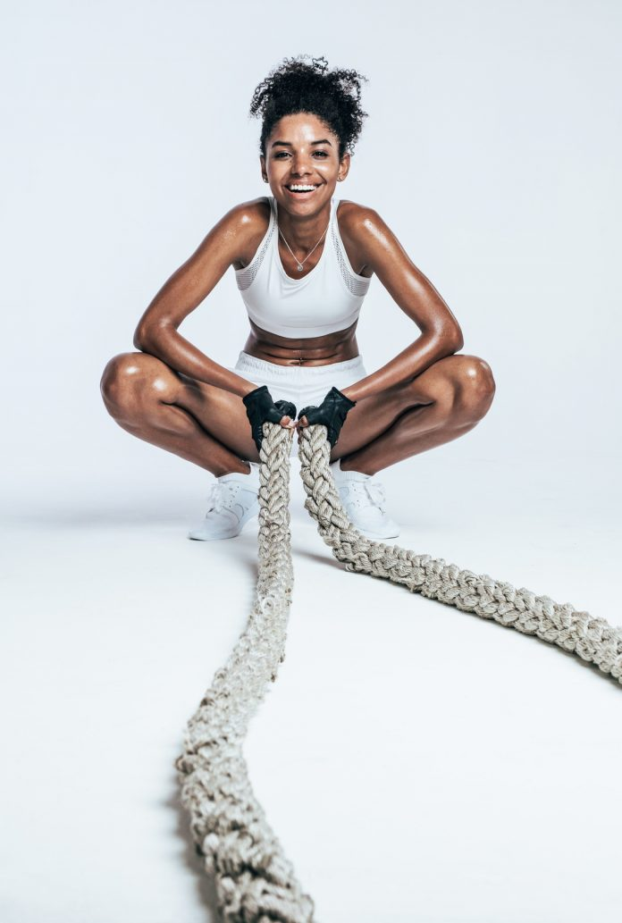 woman performing Battle Rope Exercises