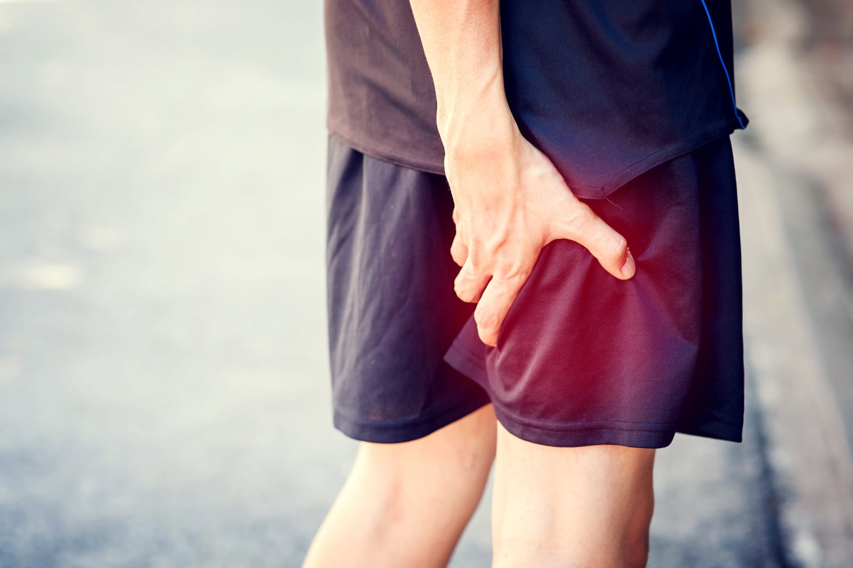 runner trying to Stop Muscle Soreness While Running
