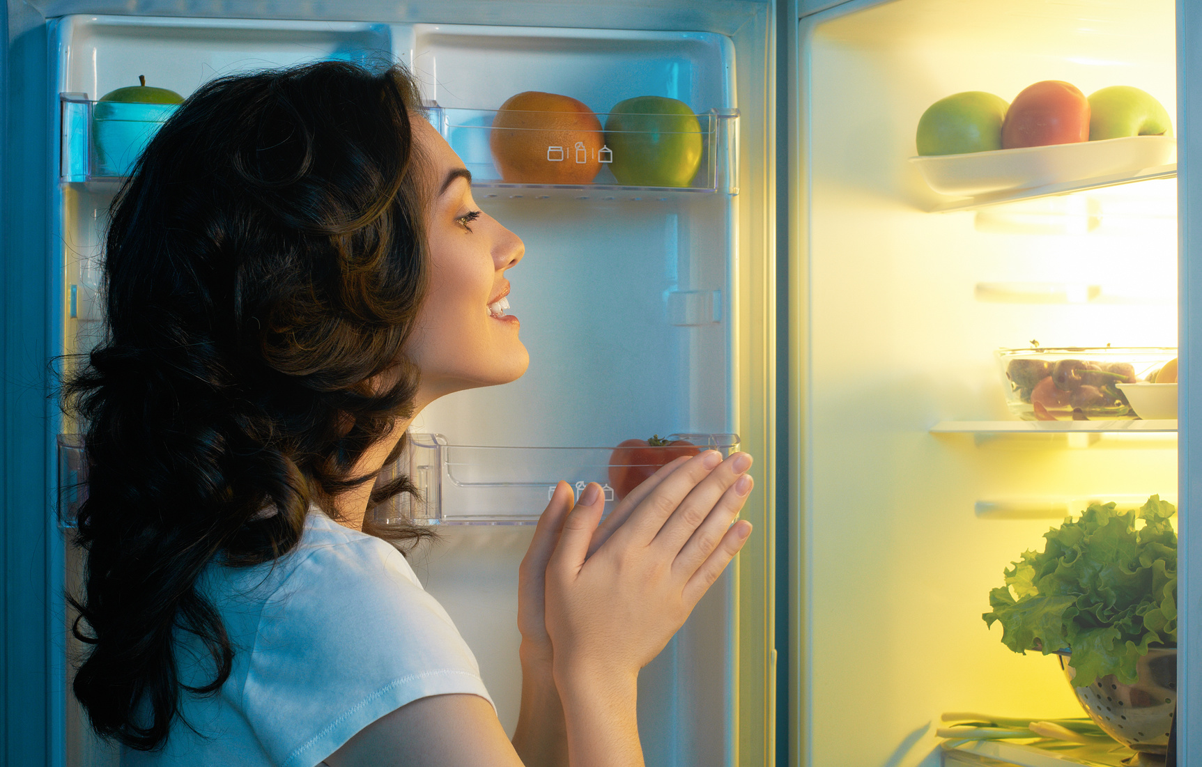 woman choosing healthy snacks at night