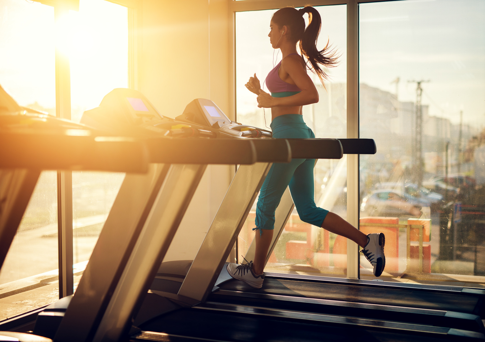 women running on treadmill for first time