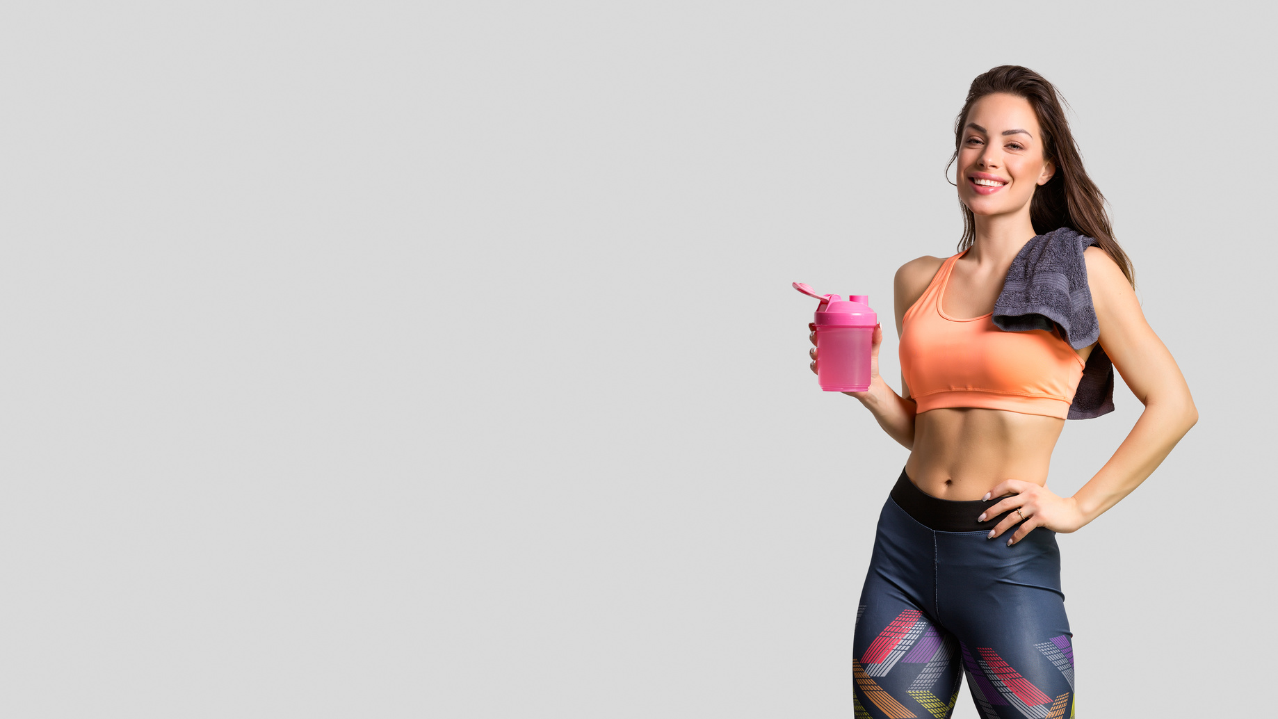 female runner drinking after a workout